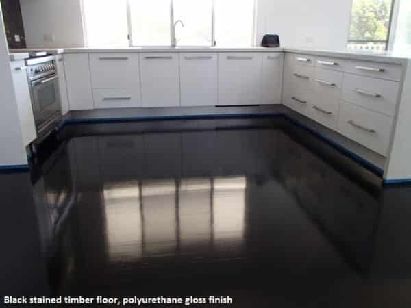 Black timber floor with gloss finish